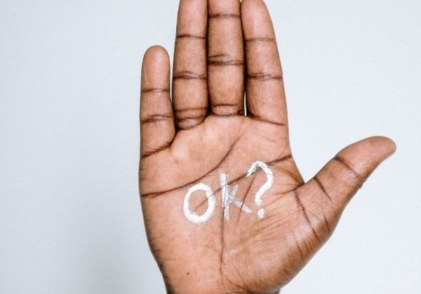 Image of a hand with 'OK?' written on it...